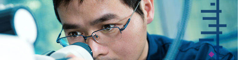 Image of a man looking into a microscope with the Cochrane logo
